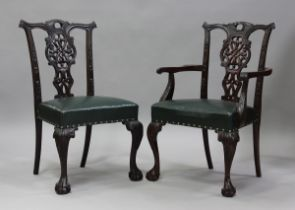 A set of ten late 19th/early 20th century Chippendale style mahogany dining chairs with pierced