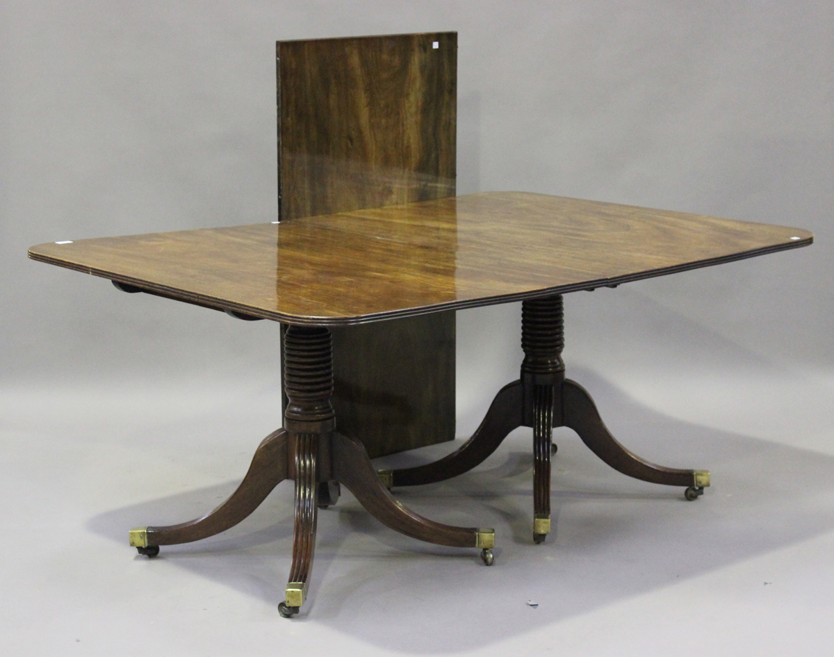 A Regency mahogany twin pedestal dining table with single extra leaf, height 73cm, extended length