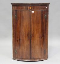 A George III mahogany hanging bowfront corner cabinet with boxwood stringing, height 109cm, width