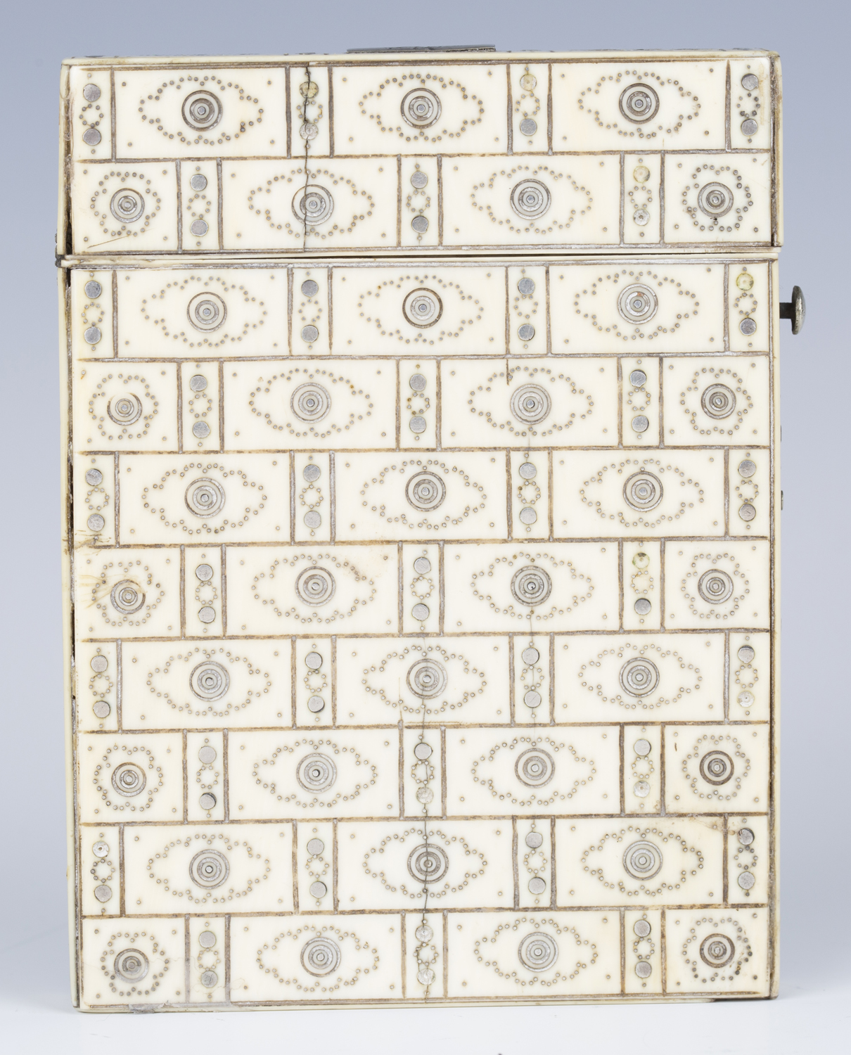 A 19th century ivory and piqué inlaid visiting card case, engraved with an overall brickwork effect,