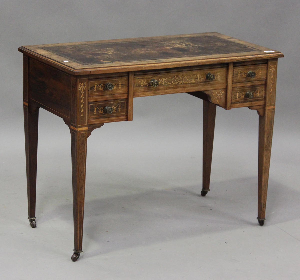 A late Victorian rosewood writing table with boxwood foliate and line inlaid decoration, height