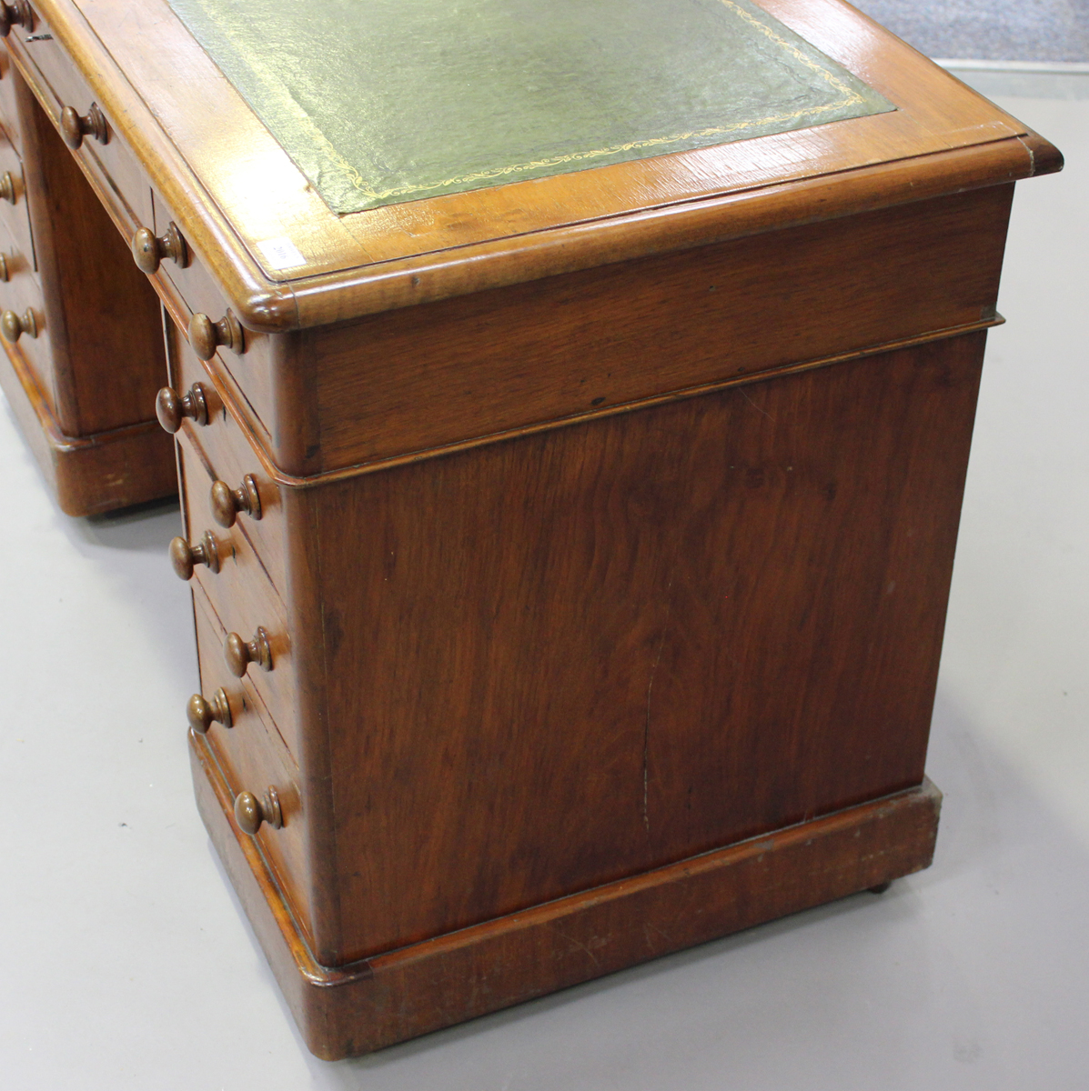 A late Victorian walnut twin pedestal desk, fitted with an arrangement of drawers, on plinth - Image 4 of 5