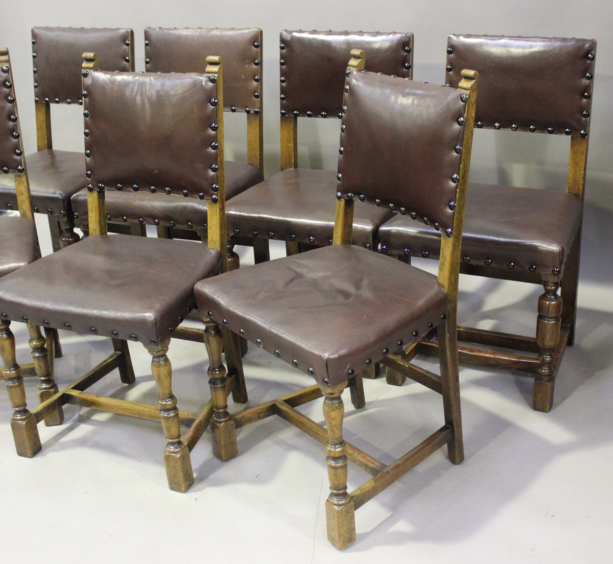 An early/mid-20th century harlequin set of seven oak framed dining chairs, comprising a set of - Image 4 of 4