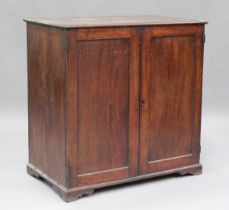 A 19th century mahogany side cabinet, the hinged top above a pair of panelled doors, on bracket