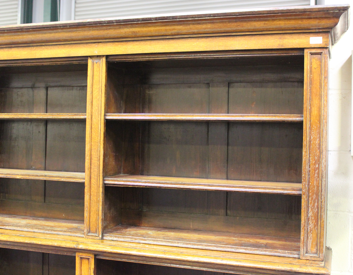 A Victorian oak open library bookcase, the moulded pediment above adjustable shelves, on a plinth - Image 2 of 5