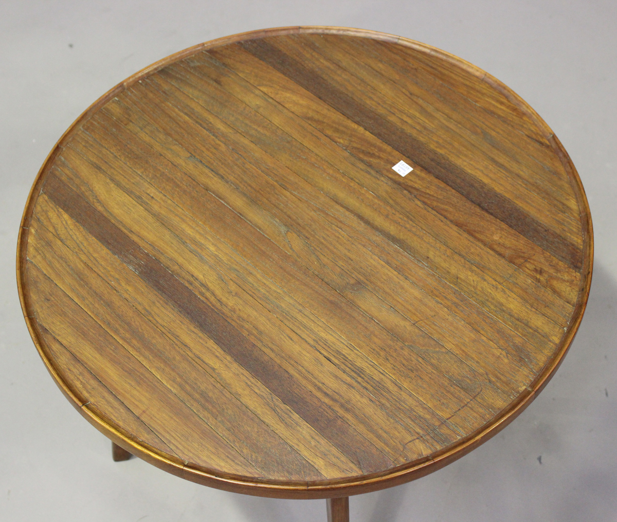 A mid-20th century teak circular occasional table of retro design, the planked top with raised edge, - Image 4 of 4