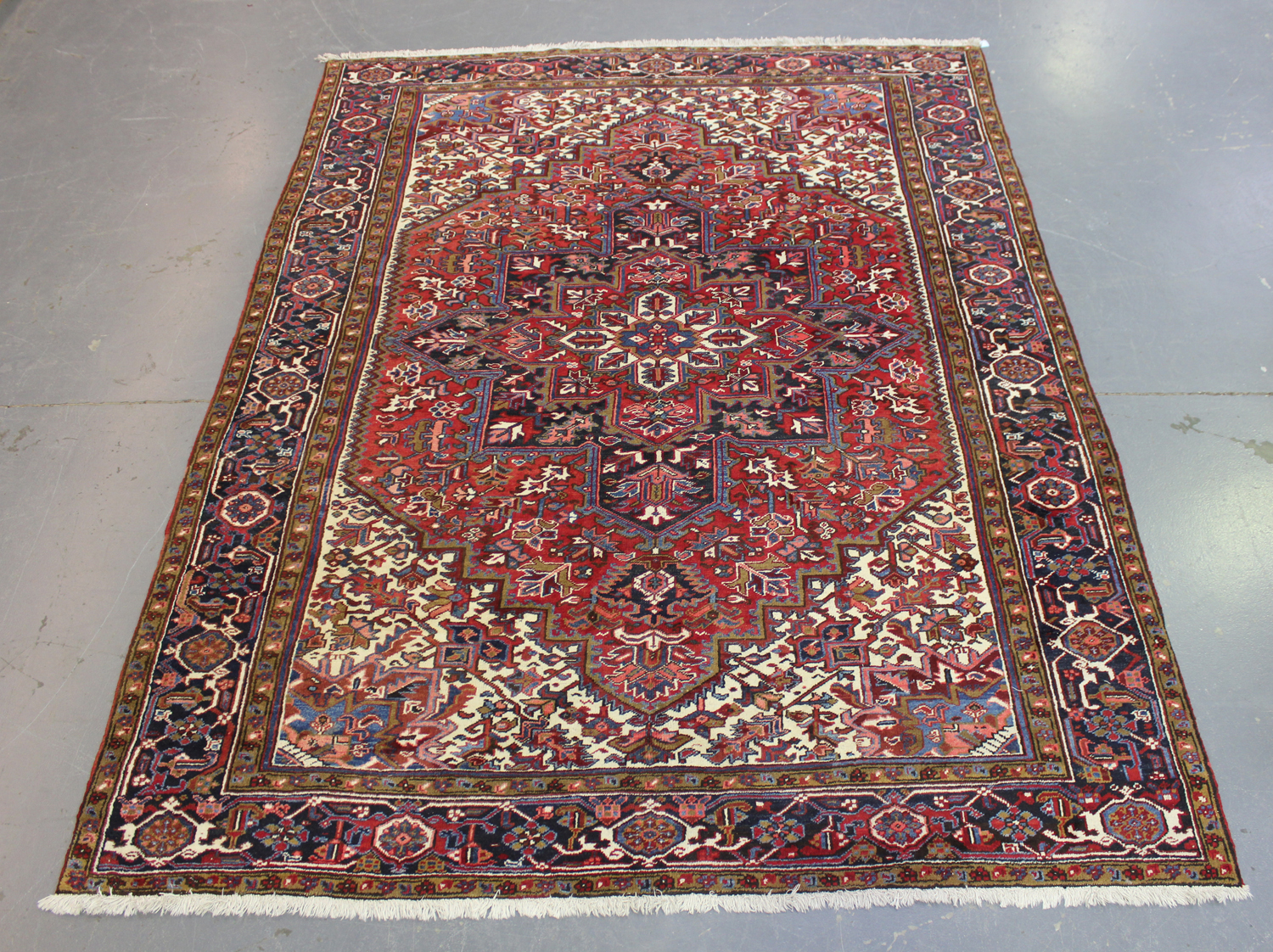 A Heriz carpet, North-west Persia, mid-20th century, the red field with a bold flowerhead