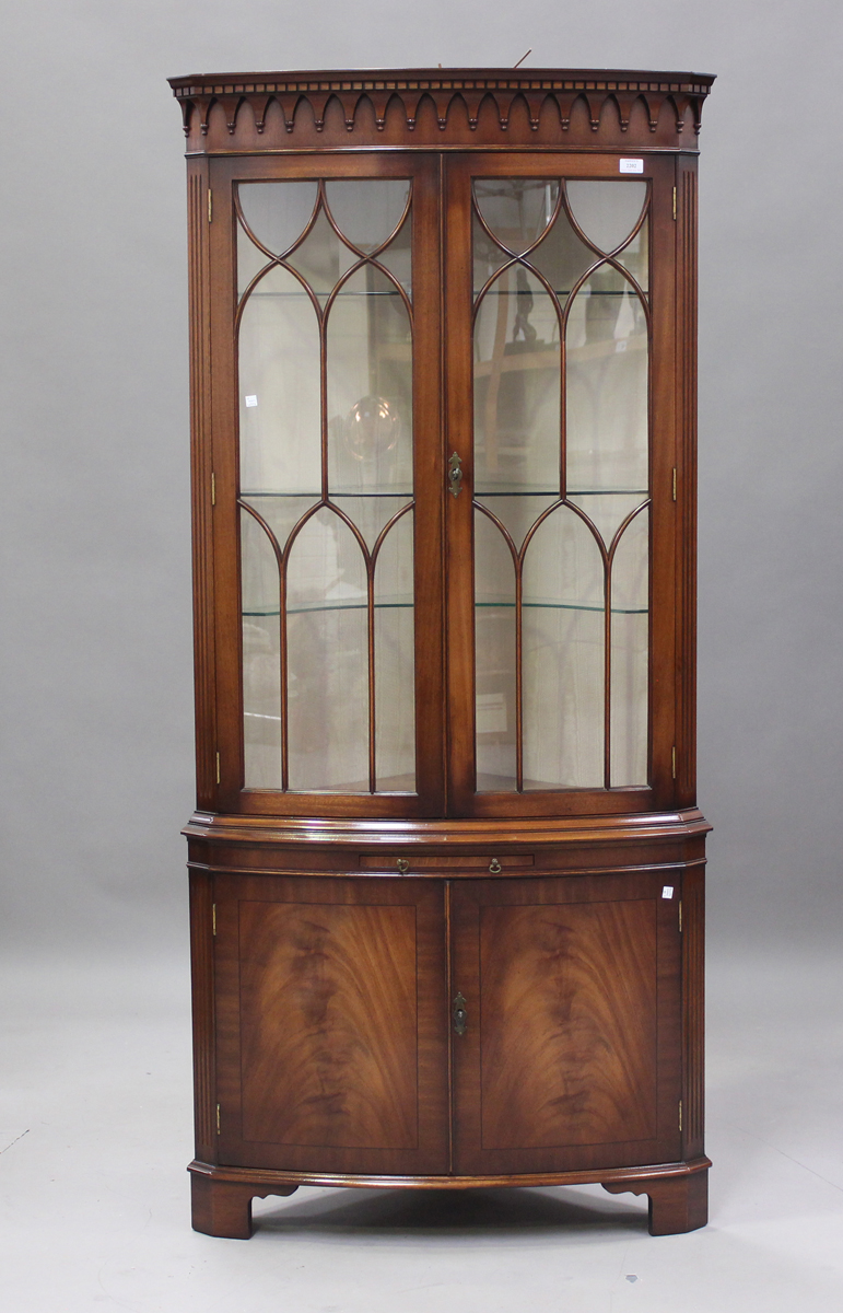 A modern reproduction mahogany bowfront corner display cabinet by Bevan Funnell, height 189cm, width