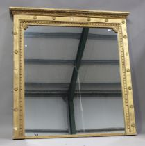 A large late Victorian giltwood and gesso overmantel mirror with moulded leaf pediment and rosette