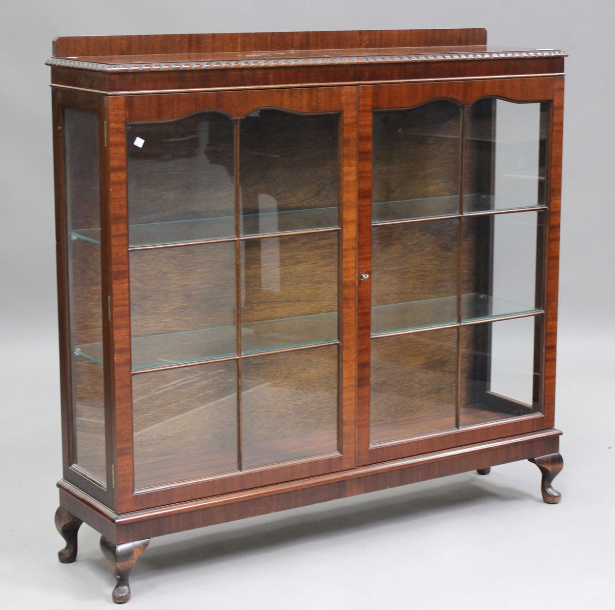 A George V mahogany display cabinet, on cabriole legs, height 120cm, width 123cm, depth 32cm.Buyer's