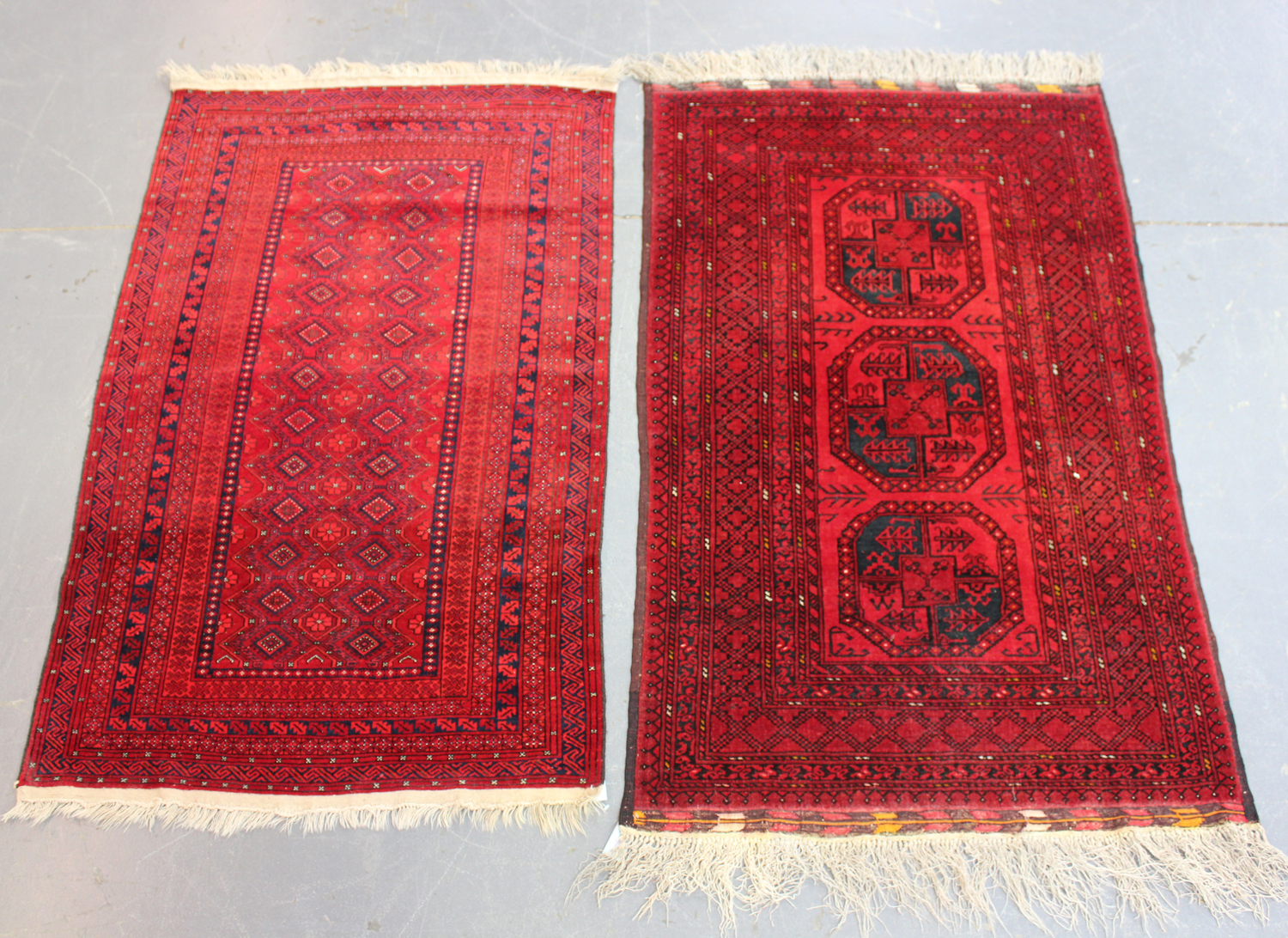 A small Afghan rug, late 20th century, 160cm x 102cm, together with another similar Afghan rug,