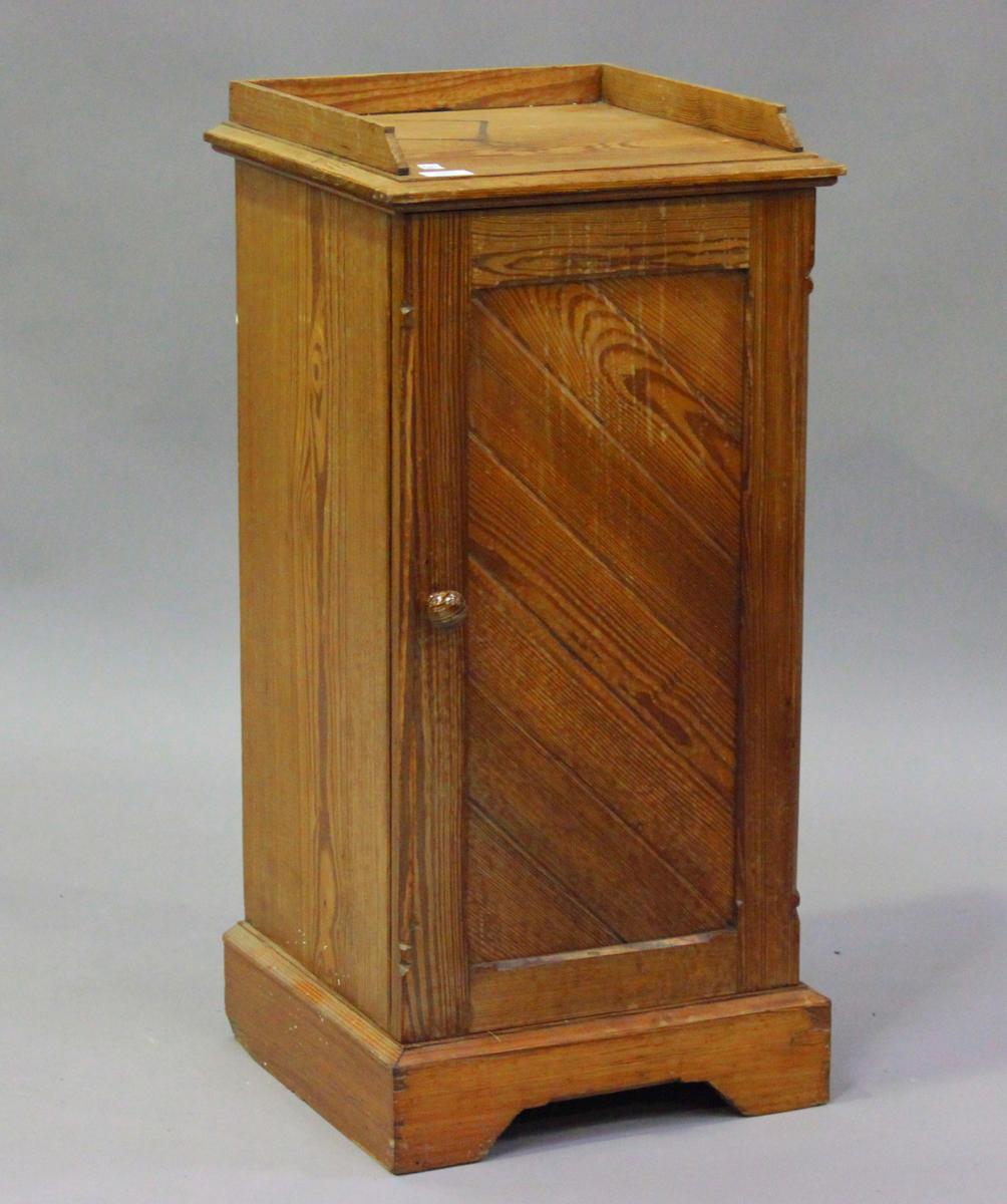 An early 20th century pitch pine bedside cupboard, height 83cm, width 39cm, depth 38cm.Buyer's