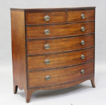 A George IV mahogany bowfront chest of two short and four graduated long drawers, on splayed bracket