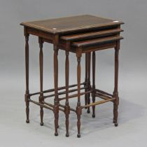 An Edwardian mahogany nest of three occasional tables with satinwood crossbanding, on turned legs,