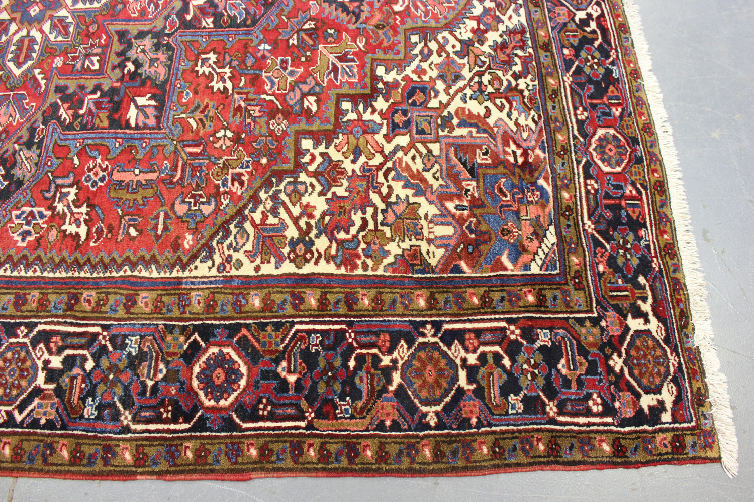 A Heriz carpet, North-west Persia, mid-20th century, the red field with a bold flowerhead - Image 6 of 6