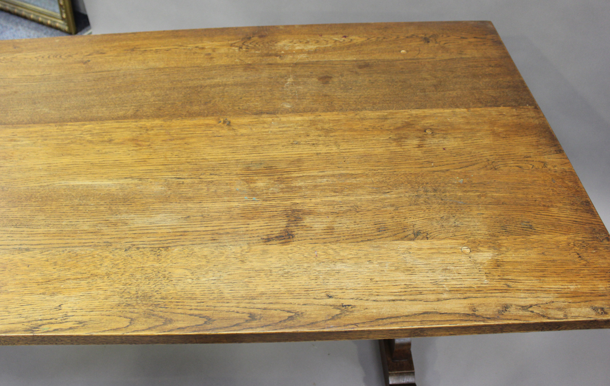 A 20th century oak refectory table, the rectangular top raised on shaped supports, height 75cm, - Image 4 of 5