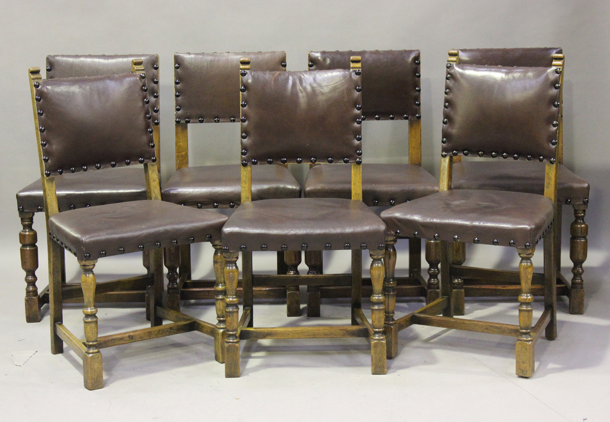An early/mid-20th century harlequin set of seven oak framed dining chairs, comprising a set of