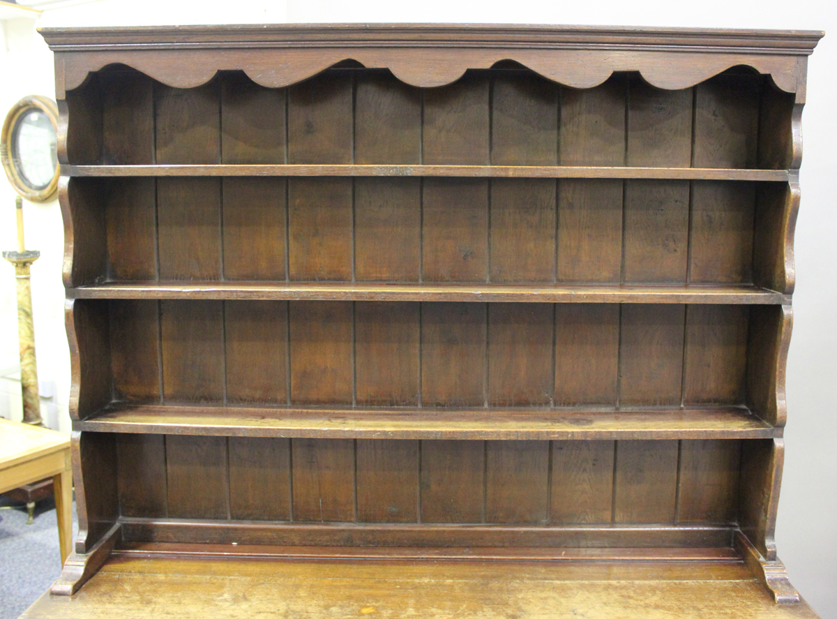 An early 20th century oak dresser, fitted with a plate rack above three drawers and a pot shelf, - Image 5 of 6