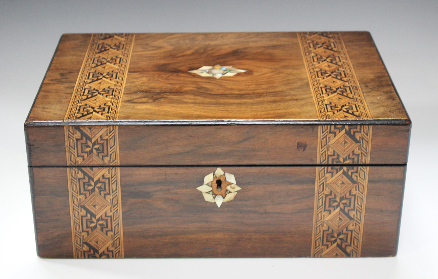 A late Victorian walnut writing slope inlaid with geometric bands, width 35cm.Buyer's Premium 29.