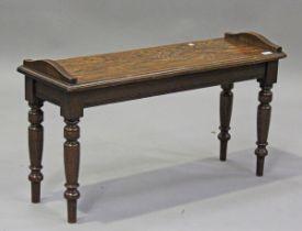 An Edwardian oak window seat, in the manner of James Shoolbred, height 51cm, width 91cm, depth