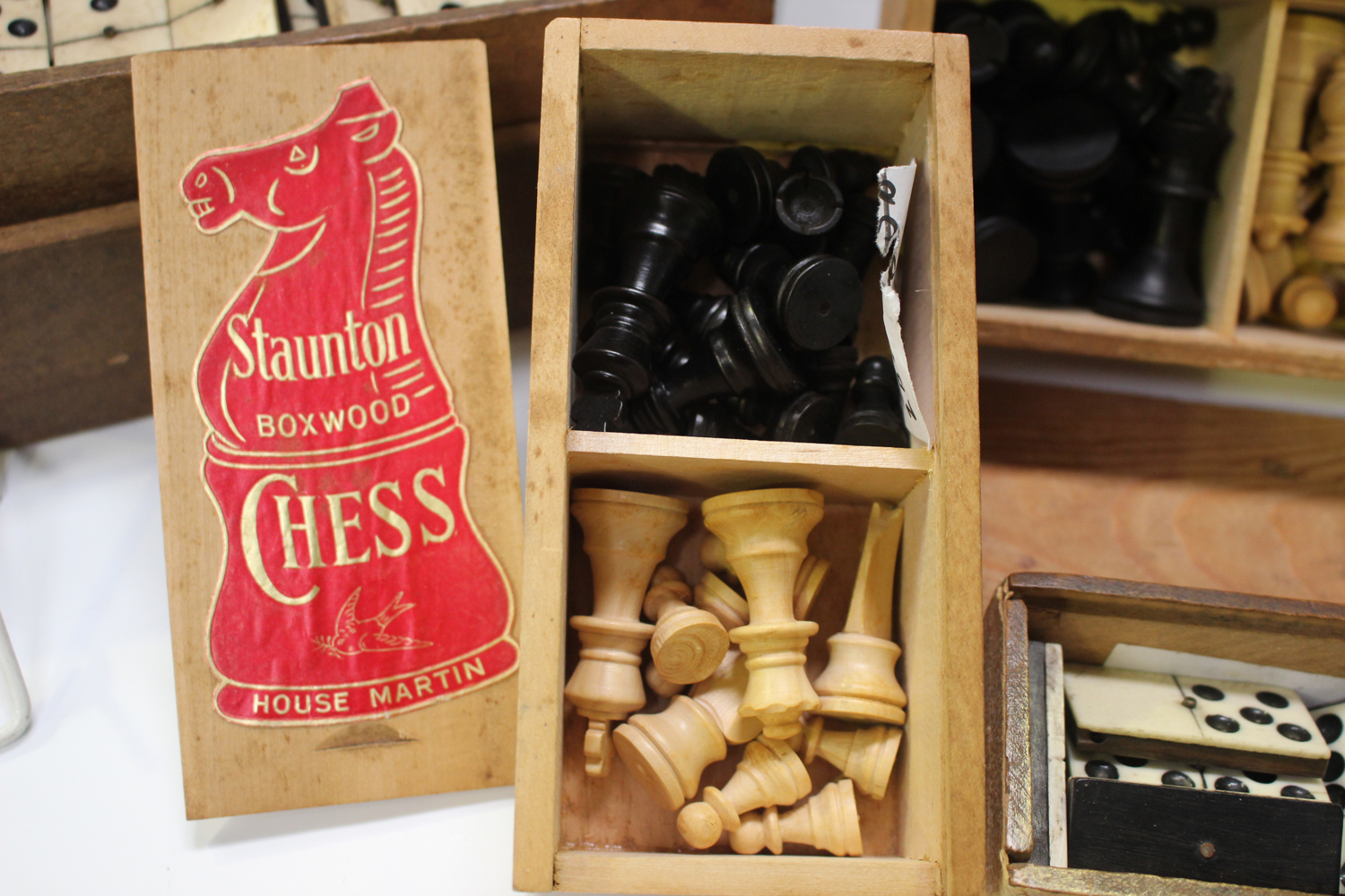 A quantity of bone and ebony dominoes, other sets of dominoes and various draught and chess pieces. - Image 4 of 8