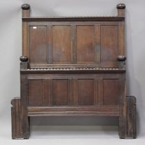 A 20th century oak panelled double bed frame, formed from 18th century oak panelling, height