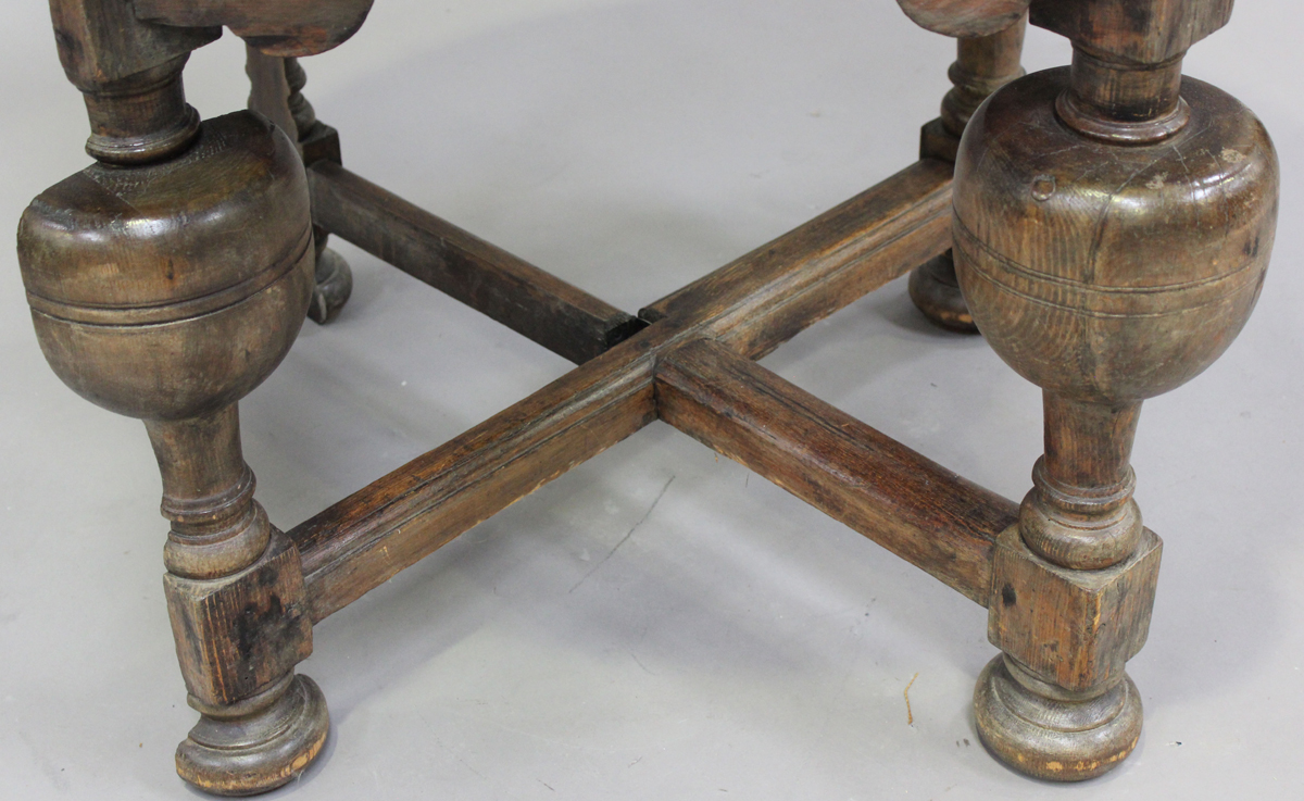 A 20th century Continental stained pine credence table, the drop-flap top raised on turned and block - Image 3 of 5