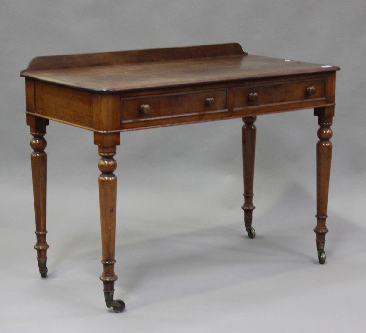 A Victorian mahogany side table, fitted with two frieze drawers, on turned legs, height 80cm,