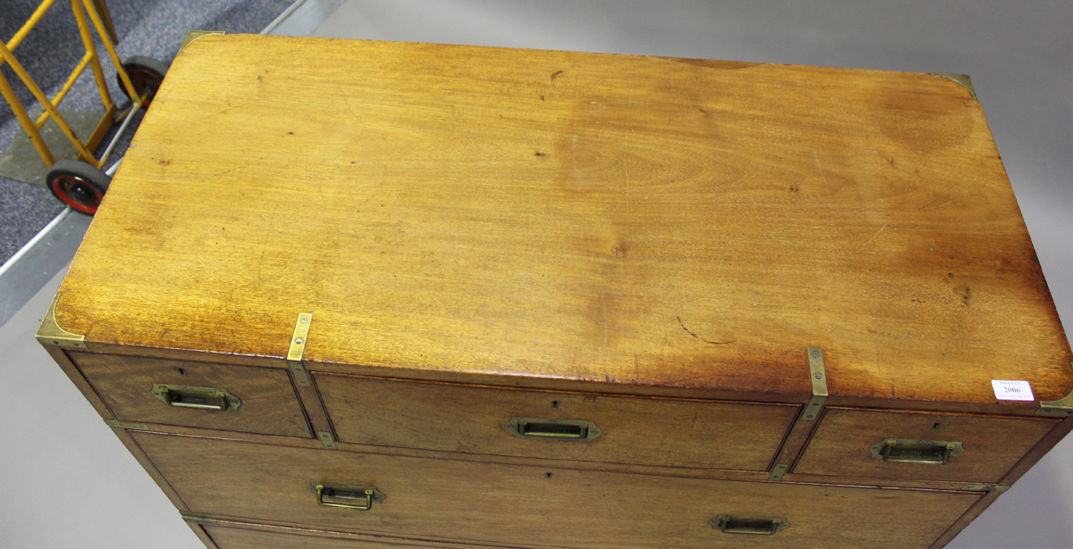 A late 19th century mahogany and brass bound campaign chest of three short and three long drawers, - Image 6 of 7