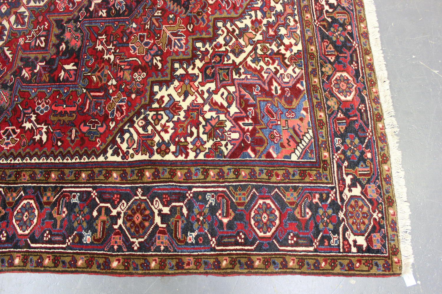 A Heriz carpet, North-west Persia, mid-20th century, the red field with a bold flowerhead - Image 4 of 6