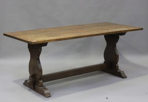 A 20th century oak refectory table, the rectangular top raised on shaped supports, height 75cm,