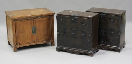 A pair of 20th century Korean softwood side cabinets, the fall-fronts revealing drawers, height