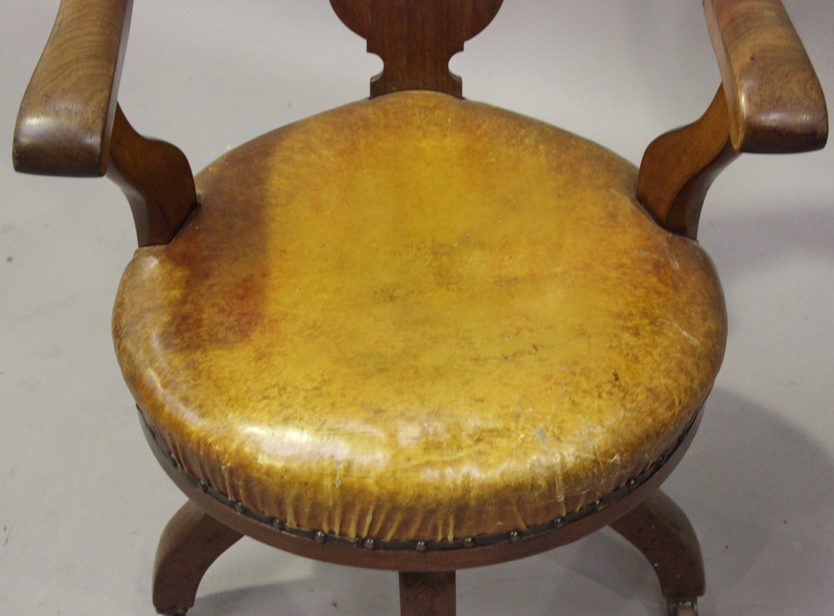 A late Victorian mahogany framed tub back revolving desk chair with a circular brown leather seat, - Image 4 of 4