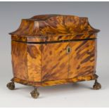 A Regency tortoiseshell tea caddy with metal stringing, the pagoda-shaped lid hinged to reveal two