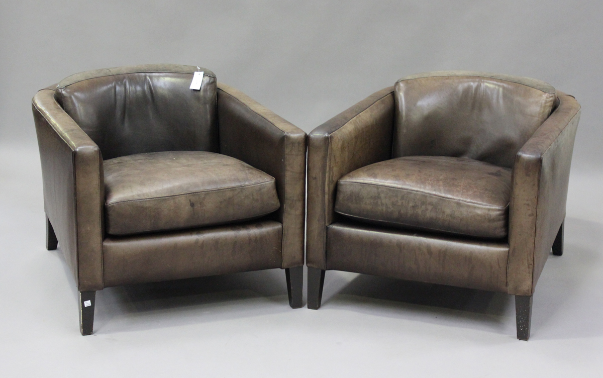 A pair of mid/late 20th century brown leather Marlborough style tub back armchairs, possibly