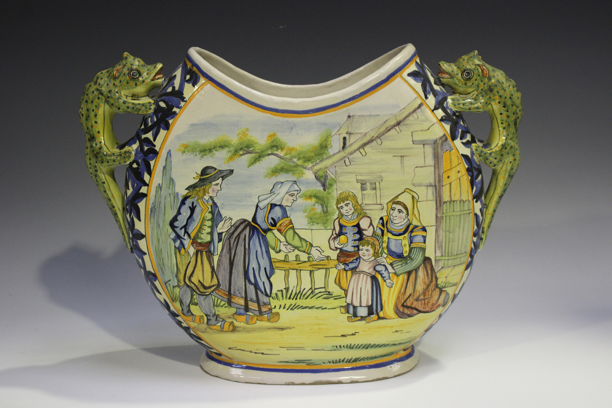 A Porquier Quimper two-handled vase, 1895-1903, the flattened body decorated with a countryside