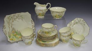 A Plant Tuscan China part tea service, decorated with primroses beneath a tree, comprising six