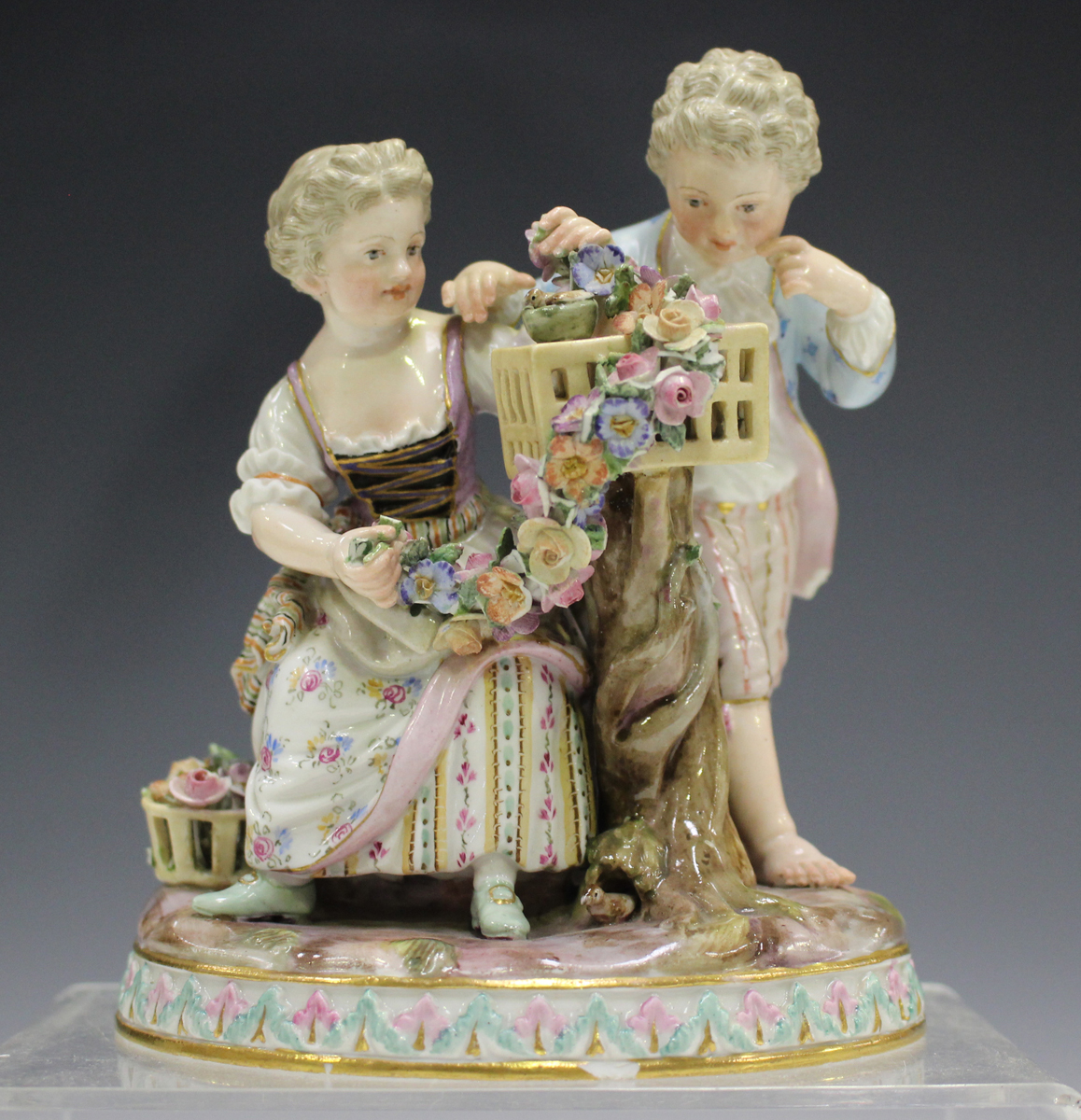 A Meissen figure group emblematic of Spring, late 19th century, modelled after Schönheit as a boy
