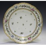 A French porcelain circular dish, late 19th century, painted to the centre with scattered floral