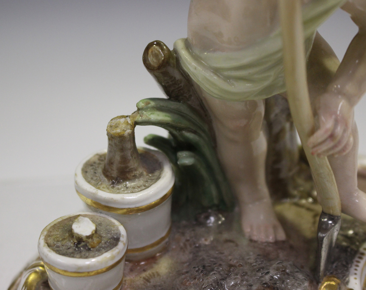 A Meissen figure of a putto gardener, late 19th century, modelled digging with a spade, a rake and - Image 4 of 7