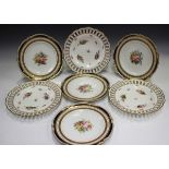 A set of four Royal Crown Derby dessert plates, circa 1919, each painted with a central floral
