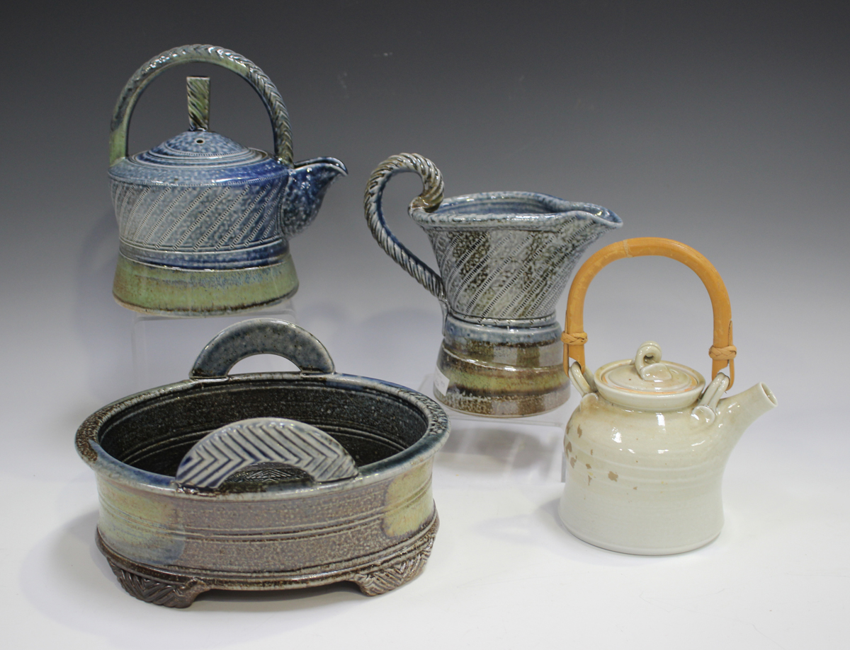 Four pieces of Jane Hamlyn studio pottery, including a salt glazed teapot, height 16cm, and a