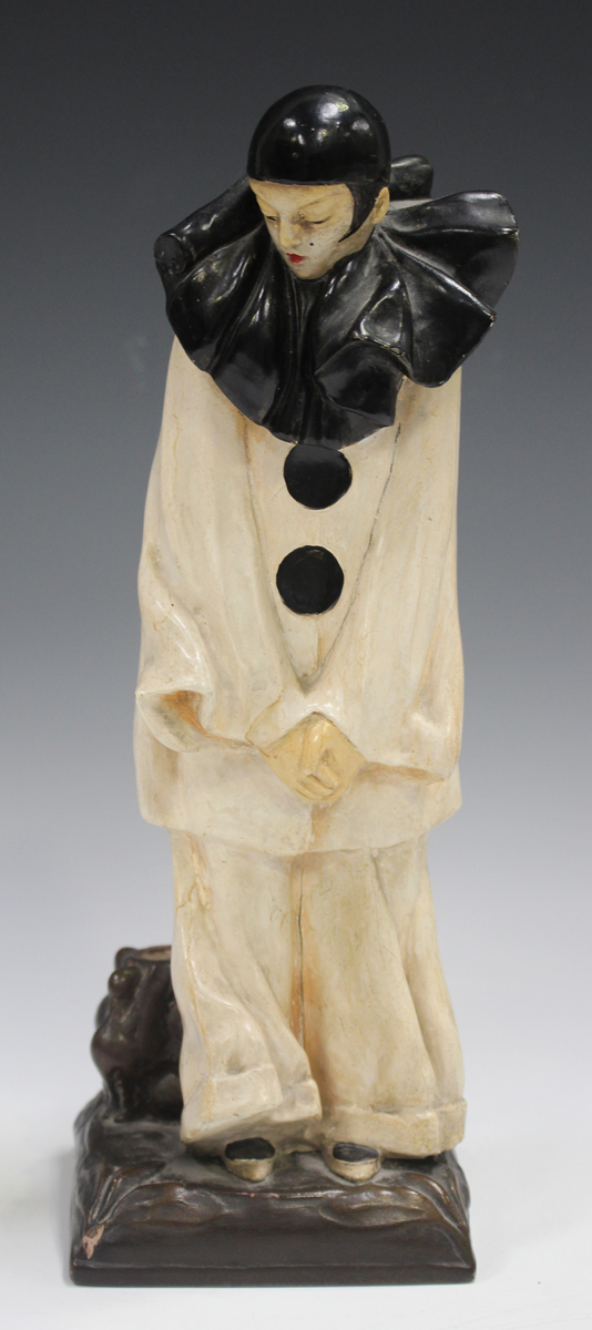 An Italian pottery figural lamp base, 20th century, inspired by a design by Roland Paris, modelled