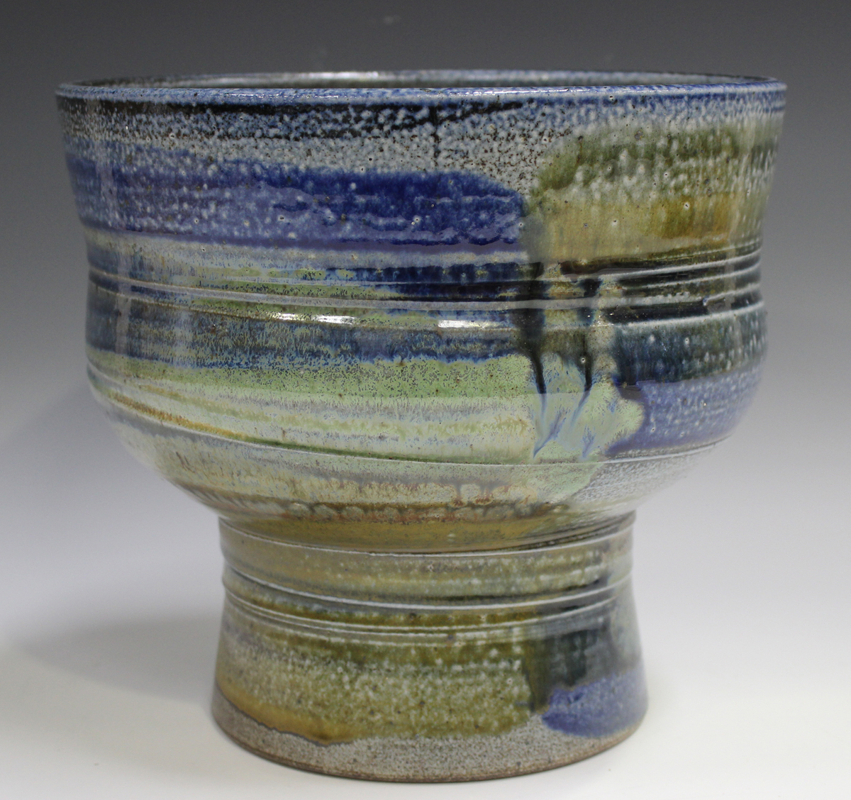 A large Jane Hamlyn studio pottery salt glazed footed bowl, decorated in shades of blue, green and