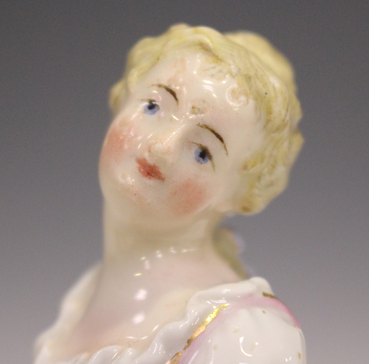 A Meissen figure of a recumbent girl, late 19th century, modelled on a naturalistic base with gilt - Image 3 of 5