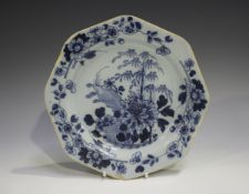 An English Delft octagonal plate, 18th century, painted in blue with a chinoiserie landscape