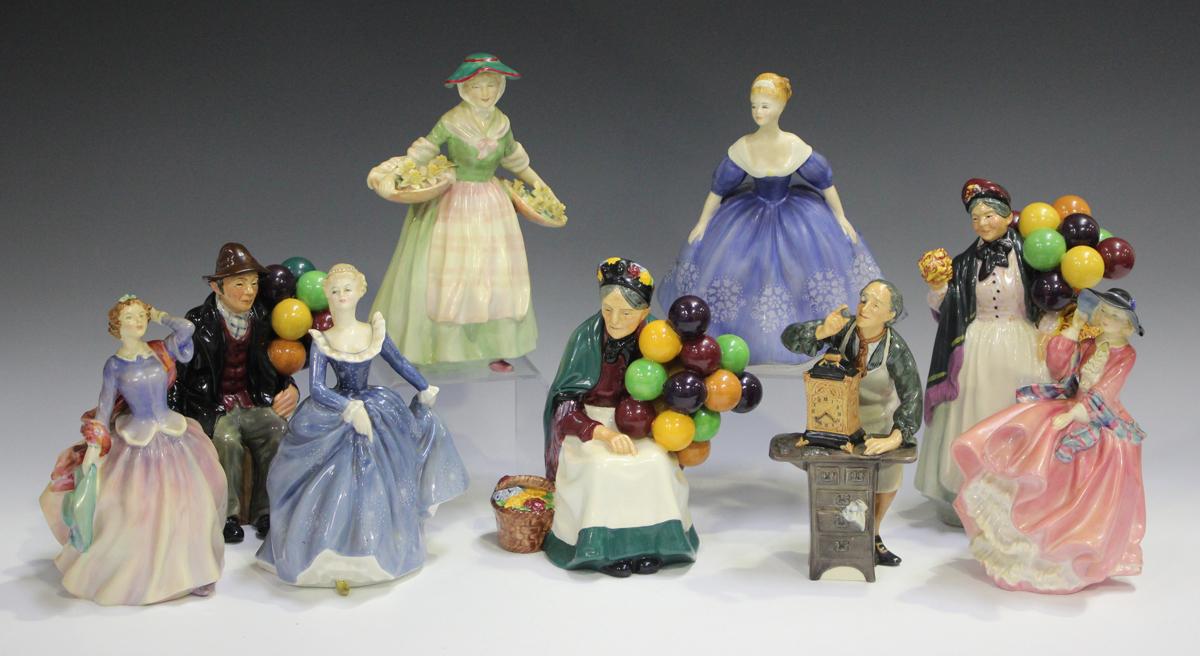 Nine Royal Doulton figures, comprising Nina, HN2347, Daffy Down-Dilly, HN1712, The Clockmaker,