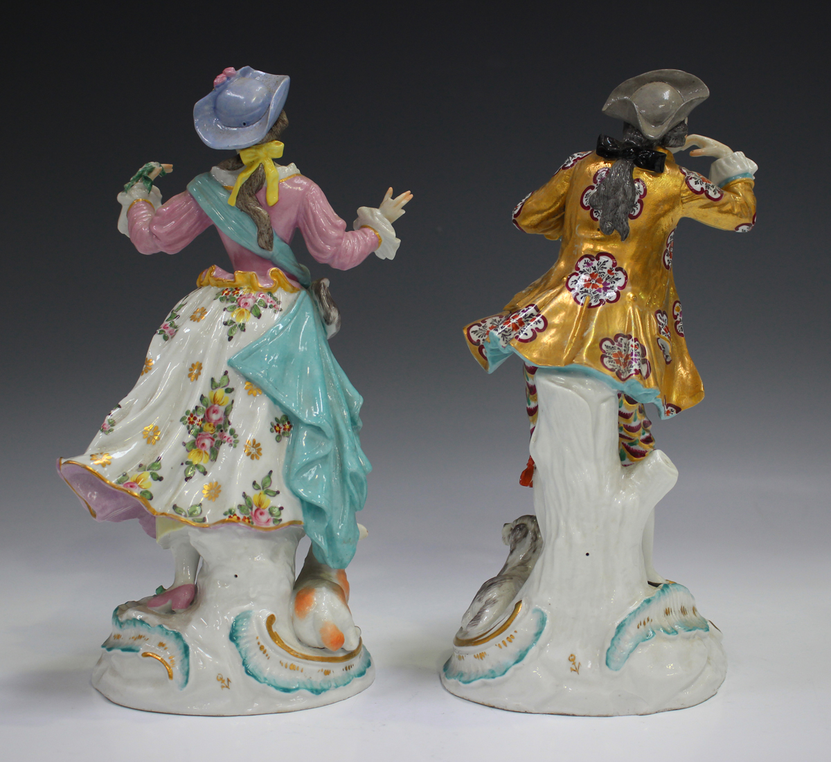 A pair of Continental porcelain figures, late 19th century, modelled in Chelsea style as a gallant - Image 6 of 6
