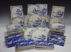 A group of approximately fifty Dutch Delft blue and white tiles, late 19th/early 20th century,