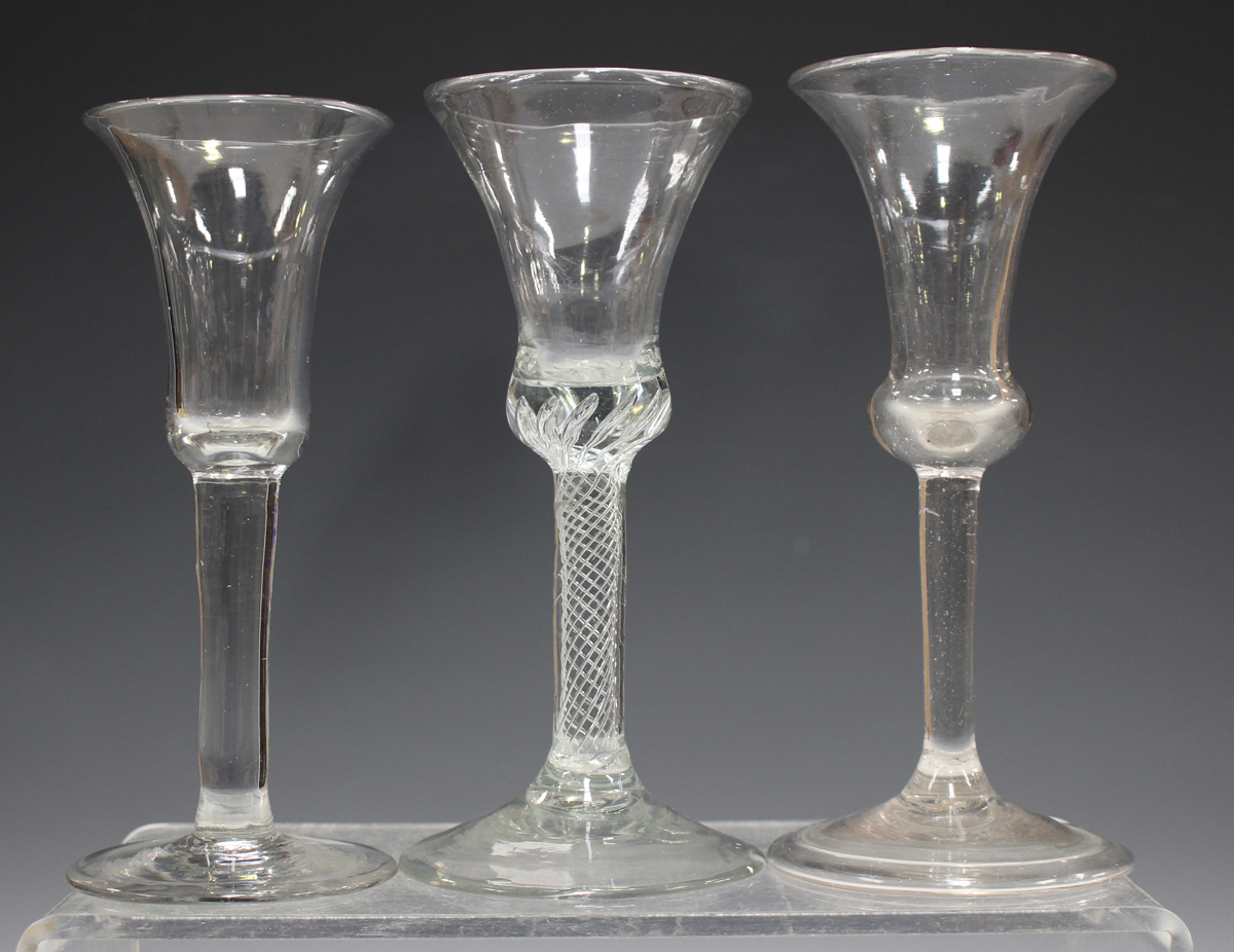 A plain stem wine glass, mid-18th century, with subtle bell bowl and conical foot, height 15.8cm,